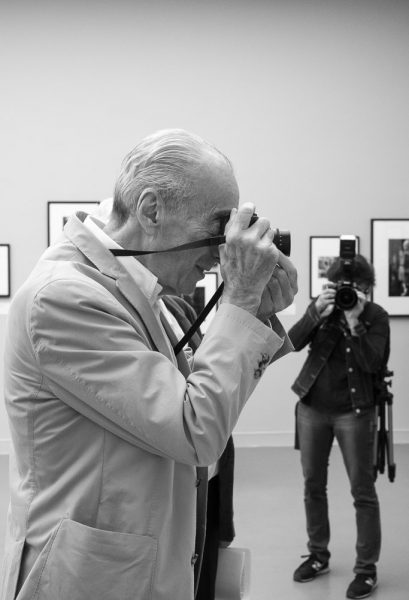 Benjain Katz shooting someone during the opening of his exhibition in Paris
